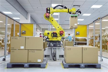 智慧工厂:1个机器人顶3个搬运工